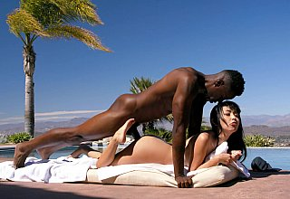 Brunette Asian babe fucked by the pool